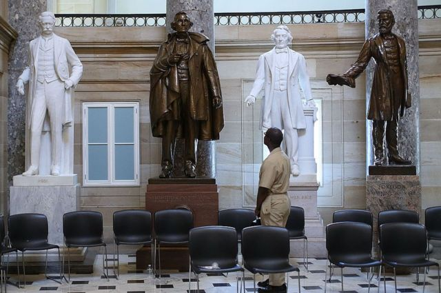 black man looks at confederate soldier