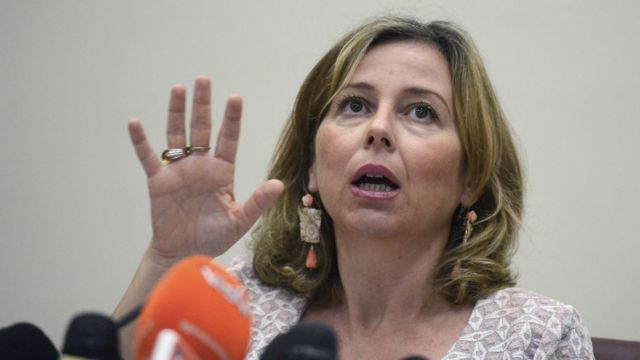 Giulia Grillo gestures while speaking at a press conference