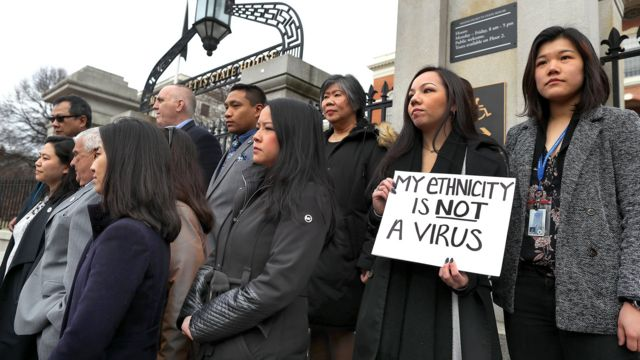 Members of the Asian American Commission hold a press conference on the steps of the Massachusetts State House to condemn racism towards the Asian American community because of coronavirus on March 12, 2020 in Boston