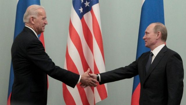 Putin greets US Vice President Biden during his meeting in Moscow in March 2011.