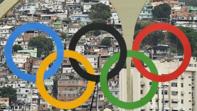 Favelas are seen behind the Olympic rings on Day 5 of the Rio 2016 Olympic Games at the Sambodromo on August 10, 2016 in Rio de Janeiro, Brazil