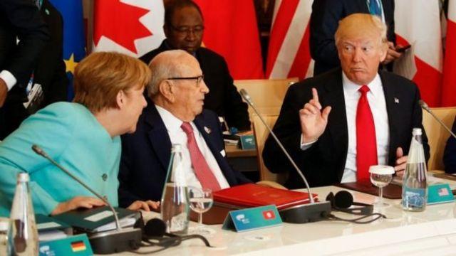 Trump con Merkel en la reunión del G7.