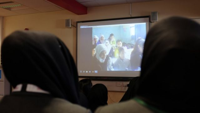 Students from Oaklands School in Tower Hamlets during a link-up with a school in Damascus, Syria
