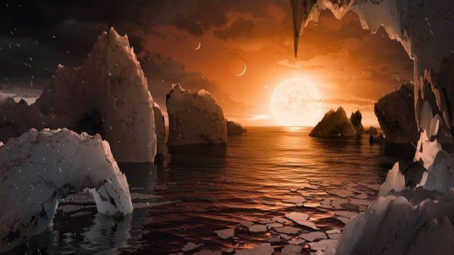Ilustración de un artista sobre cómo sería la superficie de uno de los planetas de Trappist-1.