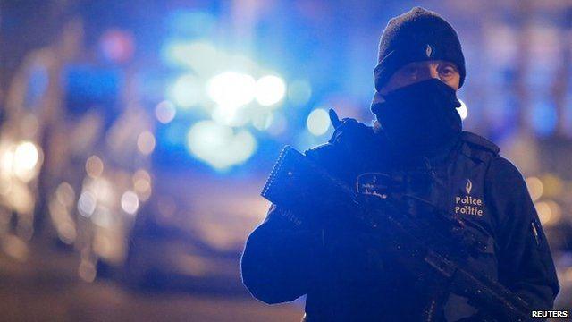 A masked Belgian police officer