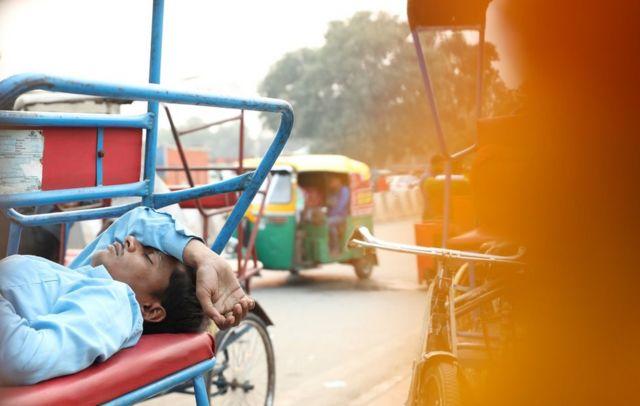 A rickshaw puller sleeping