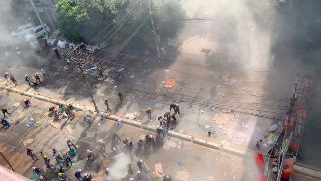 Tear gas and smoke bombs as protesters clash with police
