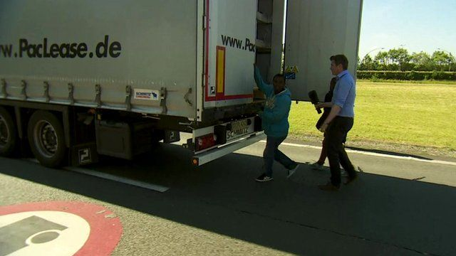 Ed Thomas approaches a man who seems to be trying to board a lorry