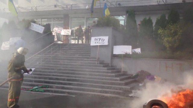 Fire outside Inter TV channel office in Kiev