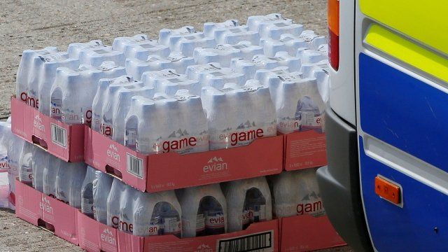 Water is unloaded for distribution to drivers on the M20