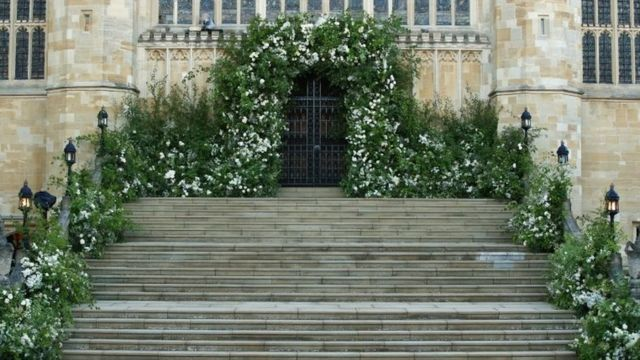Flowers and foliage surround the West Door and steps of St George's Chapel at Windsor Castle