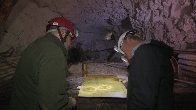 John Maguire and National Trust volunteer Gordon Wise look at original MOD plans for WW2 tunnels under Dover