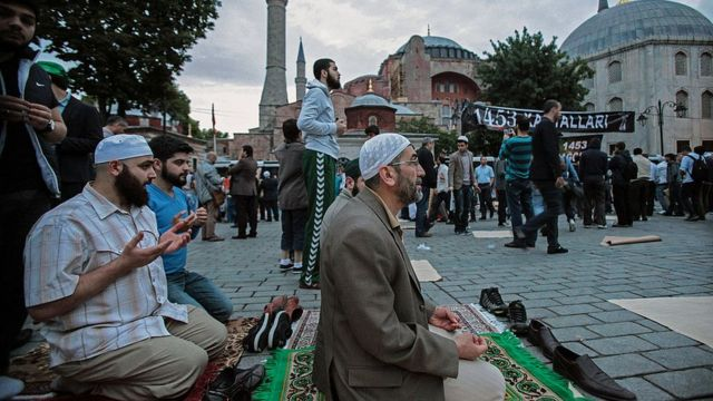 Muslims gather and pray outside the Hagia Sophia in May 2014