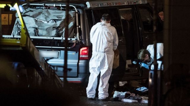 Forensics crews investigate the van used in the attack