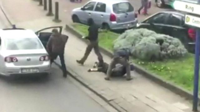 Still from amateur video showing arrest of suspect in Brussels