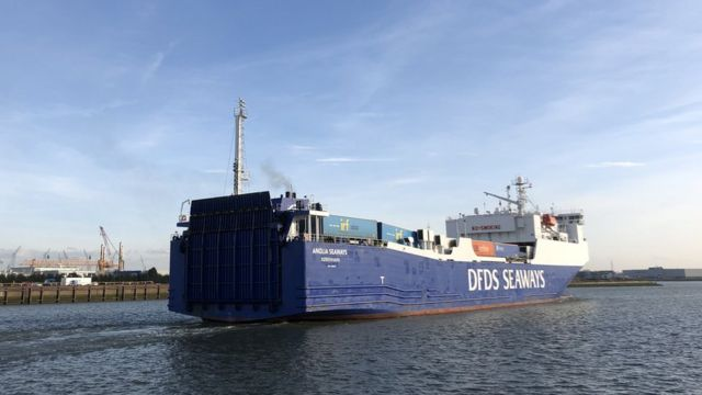 A container ship departs the port of Vlaardingen, bound for the UK