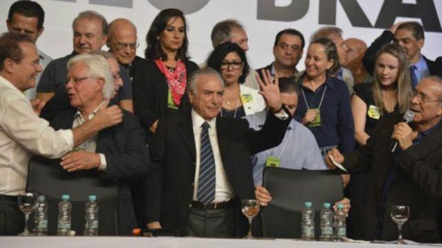 Temer na convenção do PMDB em março que o reconduziu à presidência do partido; presidente interino administra há 15 anos os diversos interesses regionais do maior partido do Brasil