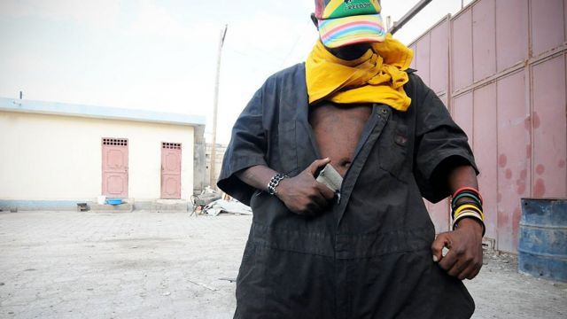 Photo of a gang member in Haiti.
