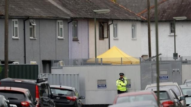 A police cordon is in place while a search continues at the property in Sunbury-on-Thames