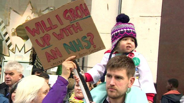 Child holding placard at NHS doctors protest