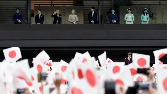"""apan""""s Emperor Akihito (3rd L) waves during his birthday public appearance with other members of the Imperial family,"""