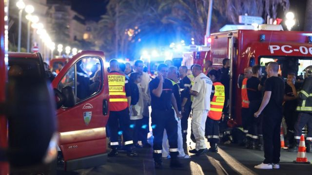 Emergency service workers and their vehicles near the attack site on the Promenade des Anglais