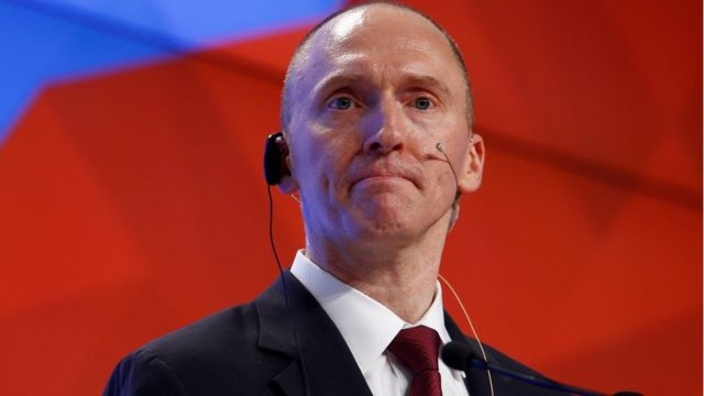 Carter Page addresses the audience during a presentation in Moscow, Russia, 12 December 2016