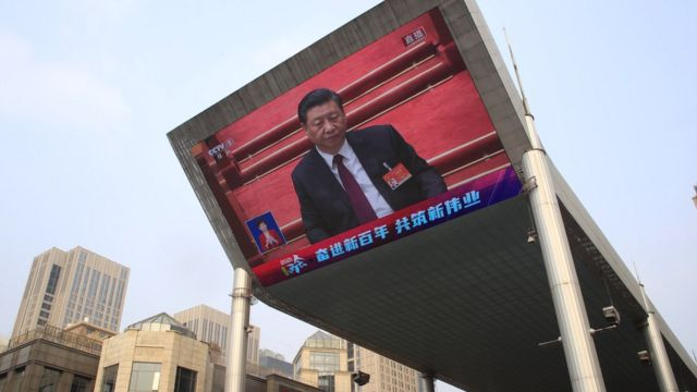 A large screen displays Chinese President Xi Jinping attending the closing session of the National People's Congress (NPC), in Beijing, China, 11 March 2021