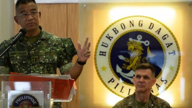 Philippines marines commandant Major General Andre Costales (L) delivers a speech beside US marines Brigadier General John Jansen during the opening ceremony of the Amphibious Landing Exercise (PHIBLEX) at the marines headquarters in Manila on October 4, 2016.