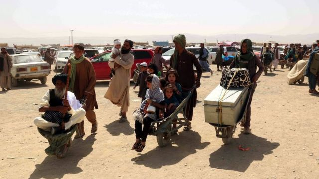 People cross the border into Afghanistan, at Chaman border, Pakistan, 20 August 2021.