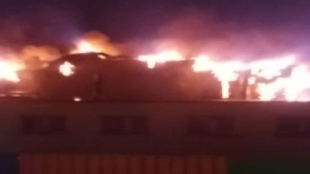 Flames rise from the roof of Holy Child Primary School