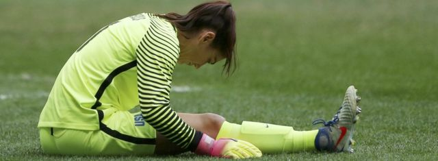 Goalkeeper Hope Solo bent double in despair at the women's football quarter finals in Rio Olympics, 12 August 2016
