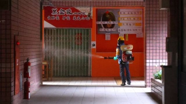 A worker disinfects a school in Taipei, Taiwan. Photo: 16 May 2021