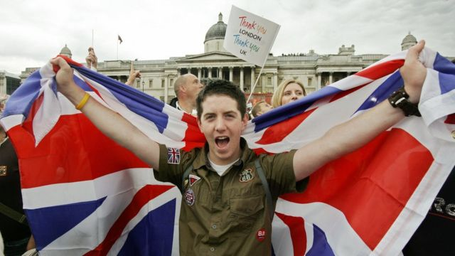 A Londoner celebrates with a Union Jack as the announcement is made that London will host the 2012 Olympic Games