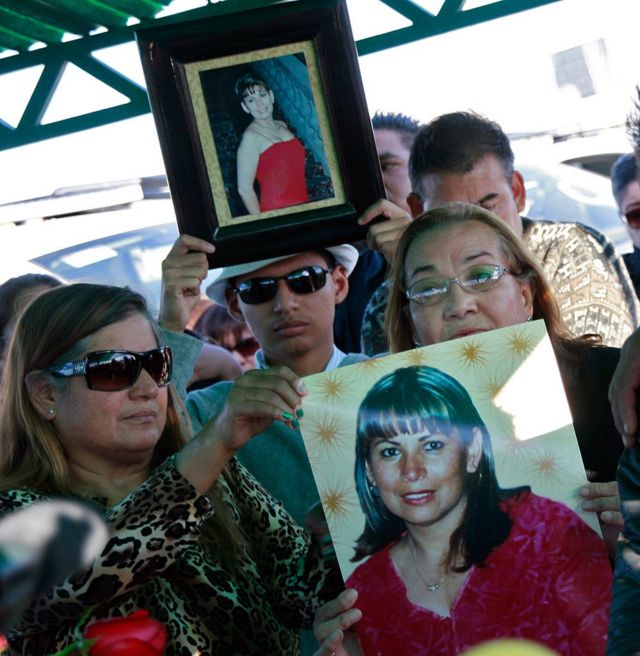 Relatives of Marisela Escobedo show photos of her during her funeral