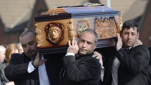 Mourners carry the coffin of Michael McGibbon
