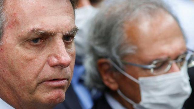 Jair Bolsonaro ao lado de Paulo Guedes