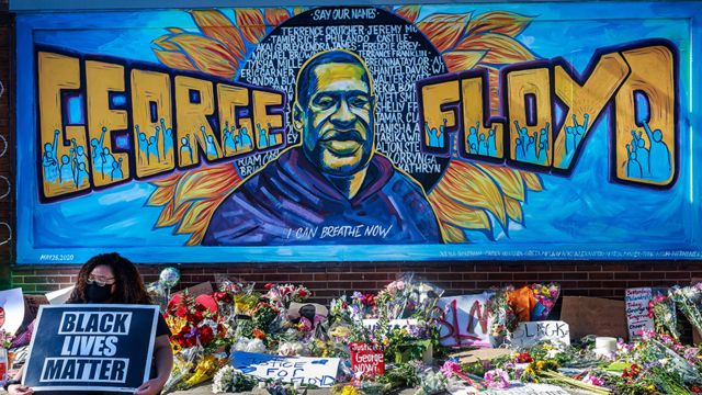 Flowers, signs and balloons are left near a makeshift memorial to George Floyd near the spot where he died while in custody of the Minneapolis police, on May 29, 2020 in Minneapolis, Minnesota