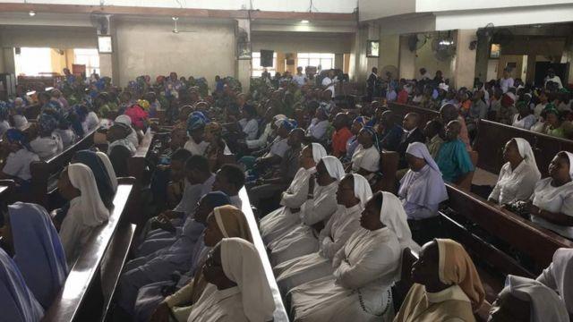 Catholics faithful as dem gada for mass inside Corpus Christi Cathedral Port Harcourt before di protest
