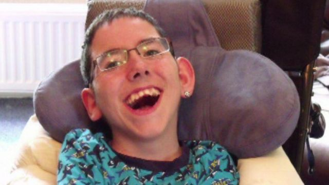 Young boy with disability laughing