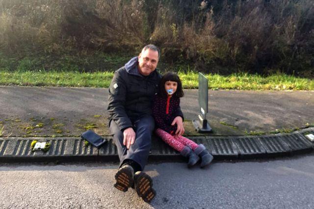 British volunteer Rob Lawrie with Azis's daughter, Chia