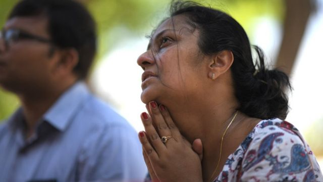 A woman prays at St Sebastian's Church in Negombo on April 22, 2019, a day after the church was hit in series of bomb blasts targeting churches and luxury hotels in Sri Lanka. - At least 290 are now known to have died in a series of bomb blasts that tore through churches and luxury hotels in Sri Lanka, in the worst violence to hit the island since its devastating civil war ended a decade ago. (Photo by Jewel SAMAD / AFP) (Photo credit should read JEWEL SAMAD/AFP/Getty Images)
