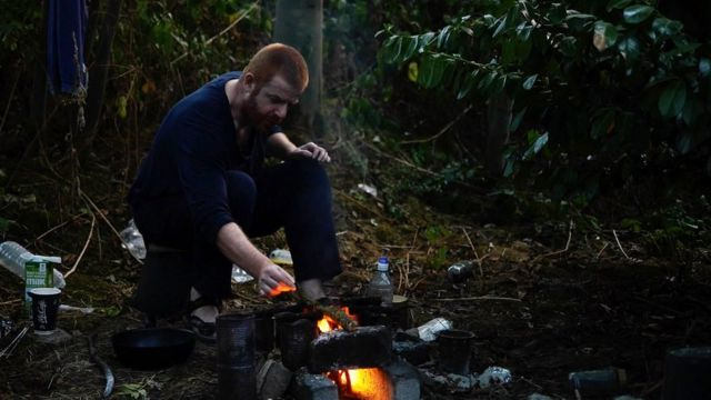 John O'Neill in a wood heating camp fire