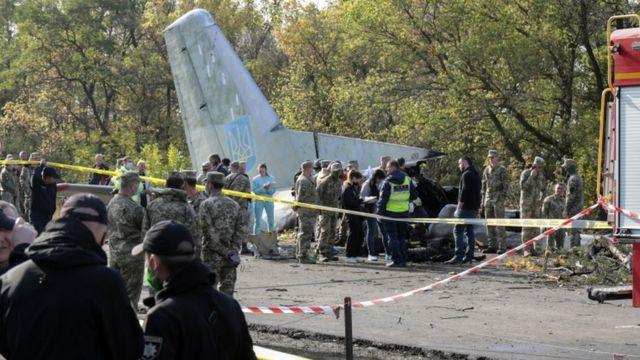 Rescuers inspect the crash site of the An-26 plane near Kharkiv, Ukraine, on 26 September 2020