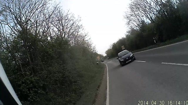 Cyclist helmet camera footage of the car swerving