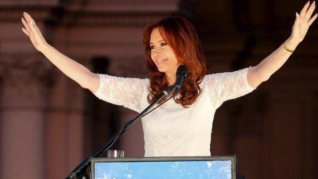Cristina Fernandez de Kirchner addresses supporters during a rally in front of the Presidential Palace in Buenos Aires