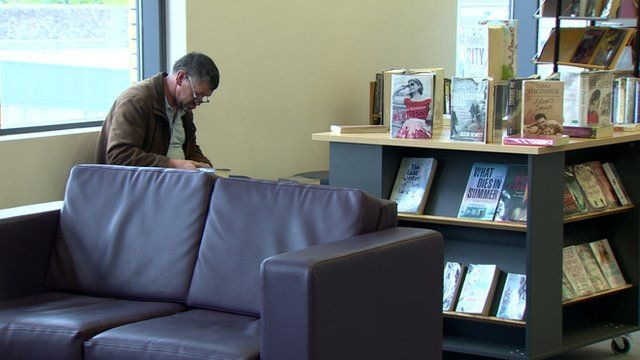 A man sitting in a library