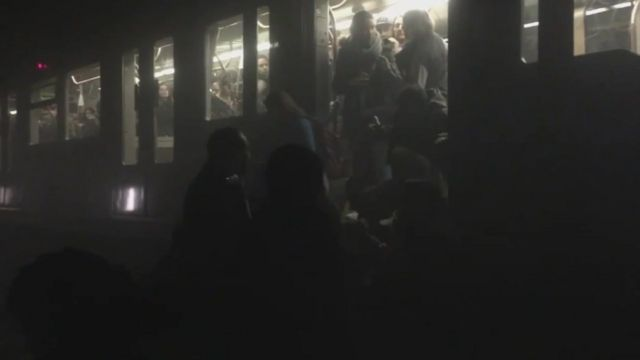 Passengers evacuating train in Belgian metro tunnel