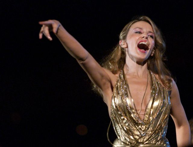 Kylie Minogue performs during the opening of the Sydney 2000 Paralympic Games at Sydney Olympic Park, Sydney Australia.
