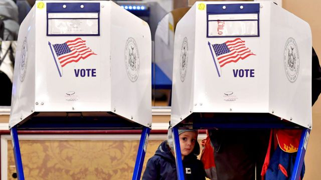 A voter casts their ballot in the midterm election